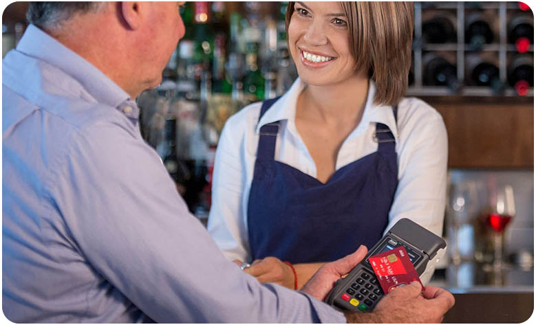 Staff member helps customer with an eftpos payment